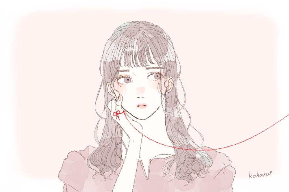 赤い糸の向こうを見つめる女性